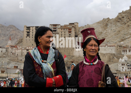 Ladakhi women wearing traditional costumes in front of Leh Palace, Ladakh, North India, Himalayas, Asia - Stock Photo