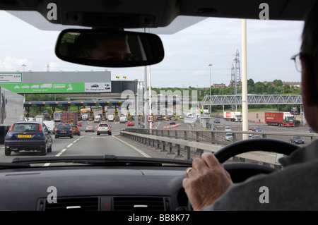 Approaching the Dartford Crossing tolls from the north, Dartford, Kent, England, UK. - Stock Photo