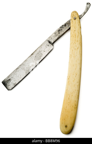 an old rusty razor on white with clipping path - Stock Photo