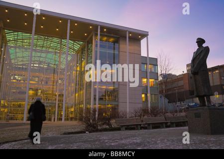 New City Hall, Radhus, and statue of King Hakon VII, polar night, winter, Tromso, Troms, Norway, Scandinavia - Stock Photo