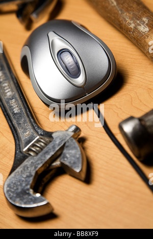 Metallic color computer mouse placed with old tools. - Stock Photo