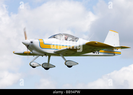 Vans RV-6A G-RVDR in flight at Breighton Airfield - Stock Photo
