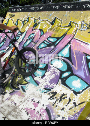person doing bike stunts on ramp at event outdoors - Stock Photo