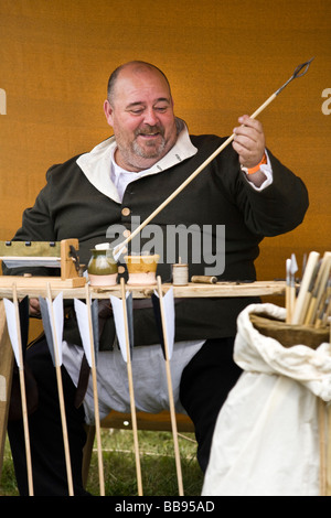 Reenactor dressed as a Fletcher or Arrow-maker at Tewkesbury Medieval Festival, Gloucestershire, UK - Stock Photo