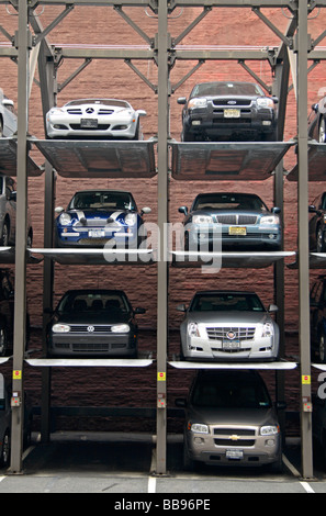 A multi level, stacked car parking system in the Soho area of New York City. - Stock Photo
