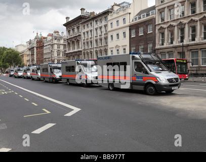 Row of Metropolitan police vans. Whitehall London England UK - Stock Photo
