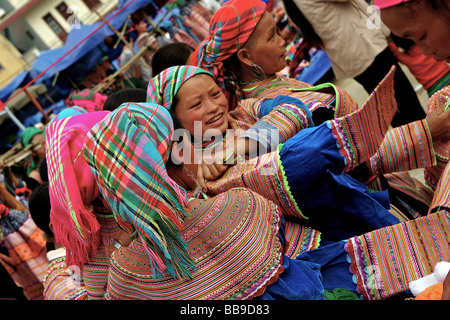 youngs flower hmong women trying on traditional clothes - Stock Photo