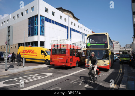 Heavy traffic with buses vans and a cyclist in Brighton city centre - Stock Photo