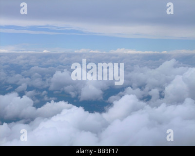 Aerial view of two layers of clouds : down, some altocumulus (Ac) clouds and up, some stratocumulus clouds (Sc) - Stock Photo