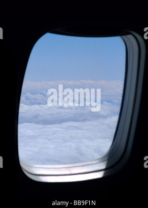 Looking out of the window on an Embraer ERJ 145 airplane - Stock Photo