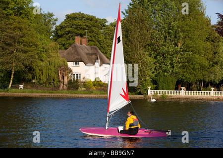England Buckinghamshire Marlow lone sailor sailing on River Thames - Stock Photo