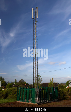 small mobile phone mast operated by vodafone in northern ireland - Stock Photo