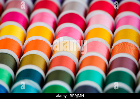 Colourful cotton reels on a market stall - Stock Photo