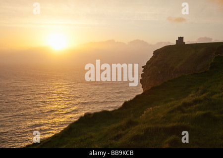 Sunset over O'Brien's Tower Cliffs of Moher County Clare Eire Ireland Irish Republic Europe EU - Stock Photo