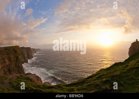 Sunset over O'Brien's Tower and Cliffs of Moher County Clare Eire Ireland Irish Republic Europe EU - Stock Photo
