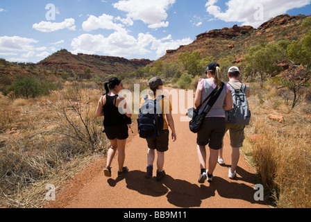 Hikers on the Kings Canyon walk.  Watarrka (Kings Canyon) National Park, Northern Territory, AUSTRALIA - Stock Photo