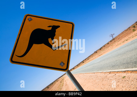 Kangaroo road sign on a remote outback road.  Northern Territory, AUSTRALIA - Stock Photo