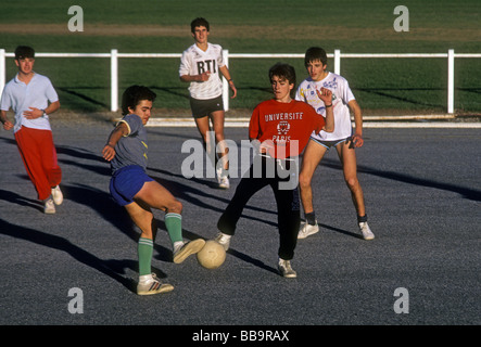 French Basque students, students playing soccer, teenage boys, soccer players, playing soccer, gym class, French - Stock Photo