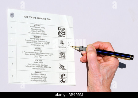 voters ballot paper for the Local Government Elections The preferred candidate is marked with a black cross - Stock Photo