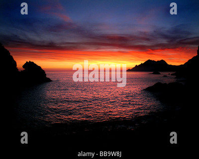 Sunset in the gulf of Porto in Corsica. Porto is famous for it's marvellous sunsets. - Stock Photo