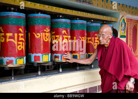 Tibetan monk spinning prayer wheels. Mcleod Ganj. Dharamsala. Himachal Pradesh. India - Stock Photo