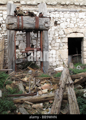 Wrecked old press Probabli used for wine or oil production in its time in Dalmatian village on Peljesac peninsula - Stock Photo
