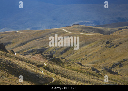 Historic Water race and Nevis Road Carrick Range looking towards Nevis Valley and Hector Mountains Central Otago - Stock Photo