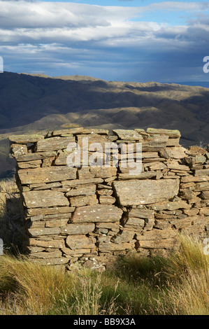 Remnants of Miners Cottage Carricktown Carrick Range Central Otago South Island New Zealand - Stock Photo