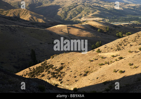 Carrick and Pisa Ranges Central Otago South Island New Zealand - Stock Photo