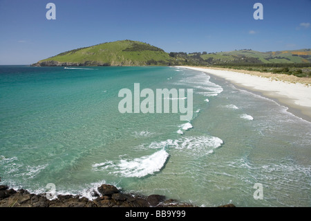 View across Purakanui Bay to Potato Point seen from Mapoutahi Historic Maori Pa Site north of Dunedin South Island - Stock Photo