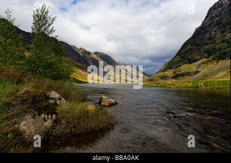 Loch Achtriochtan at the foot of Aonach Dubh in Glen Coe in the Scottish Highlands - Stock Photo