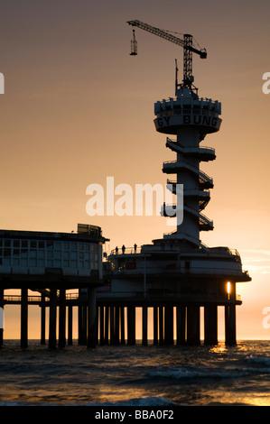 Scheveningen Pier at sunset, Scheveningen Beach, Den Haag, The Netherlands - Stock Photo