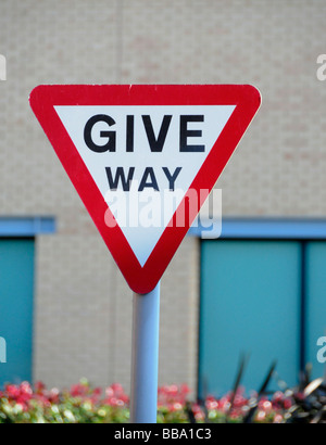 Give Way road sign on Country Lane - Stock Photo