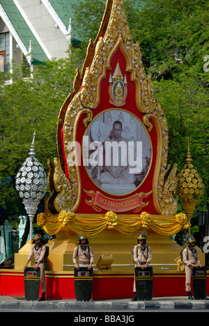 Demonstration, policemen with protective shields, standing guard in front of the statue of King Bhumipol, Bangkok, - Stock Photo