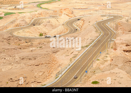 Serpentine road at the foot of Djebel Hafeet, the highest mountain in the United Arab Emirates, 1240 meters, in - Stock Photo