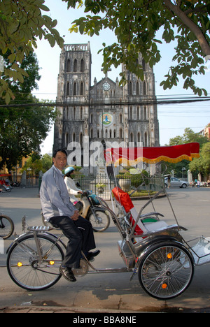 Cyclo drivers waiting, in the back the neo-Gothic St Joseph's Cathedral, Hanoi, Vietnam, Southeast Asia, Asia - Stock Photo