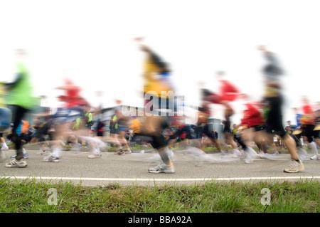 Marathon runners with motion blur - Stock Photo