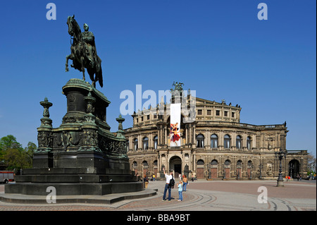 Semperoper Opera house with flags and Koenig Johann memorial, Theaterplatz square, Dresden, Free State of Saxony, - Stock Photo
