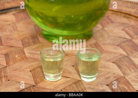 Alcohol, Green Lao Lao, Lao rice liquor in two shot glasses, Phongsali, Laos, Southeast Asia, Asia - Stock Photo