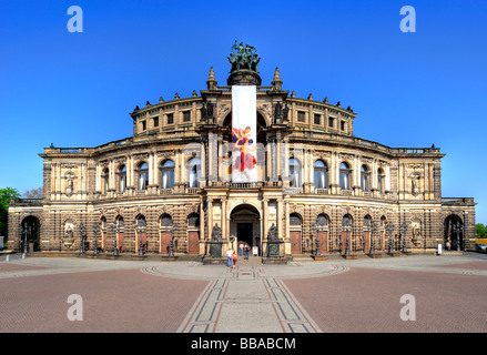 Semperoper Opera house with flags, Theaterplatz square, Dresden, Free State of Saxony, Germany, Europe - Stock Photo
