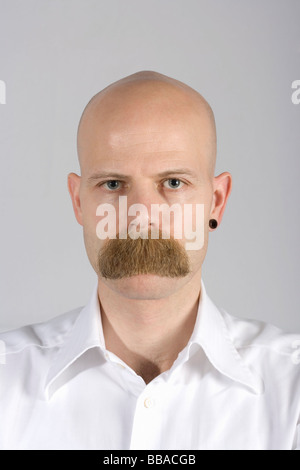 A man with long mustache hair covering his mouth - Stock Photo
