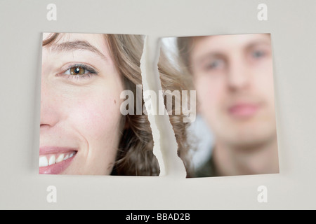 A photograph of a heterosexual couple torn in half - Stock Photo
