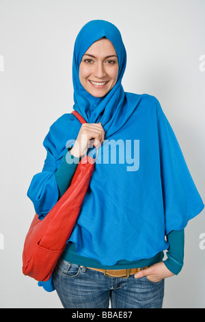 Portrait of a fashionable woman wearing a Hijab - Stock Photo