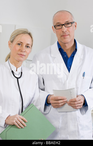 Portrait of a dentist and a dental assistant - Stock Photo