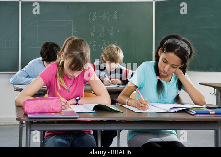 School students working in a classroom - Stock Photo