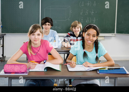 School students sitting in a classroom - Stock Photo