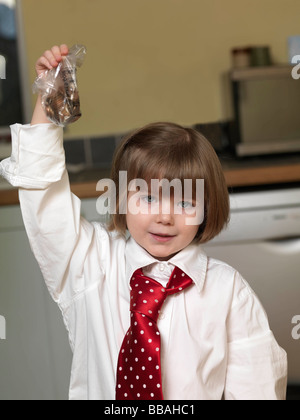 girl holding bag of coins - Stock Photo