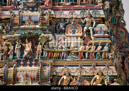 Detail showing the sculpted deities on the towered gateway ( gopuram) of the Marundeeswarar Temple in Chennai, India. - Stock Photo