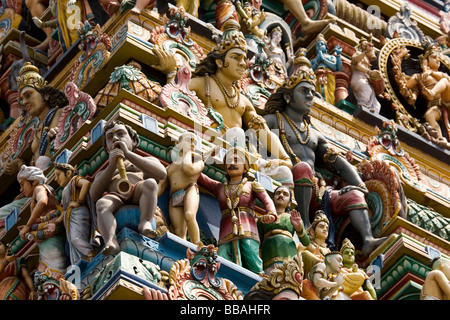 Detail showing the sculpted deities on the towered gateway (gopuram) of the Marundeeswarar Temple in Chennai, India. - Stock Photo