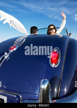 Couple in an old convertible - Stock Photo